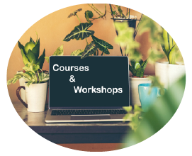 Image of computer with course and workshops written on the screen surrounded by plants